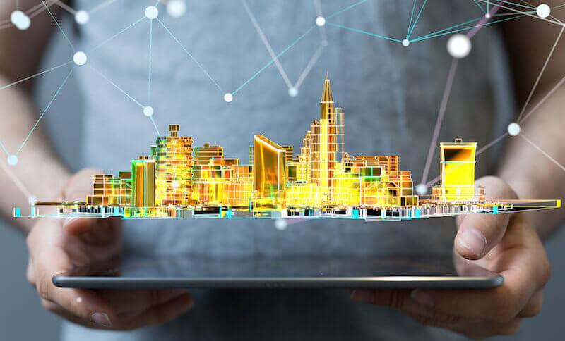 Leuchtende Stadt auf einem Tablet