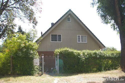 einfamilienhaus marienfelde zaun hecke