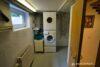 Einfamilienhaus in zweiter Reihe - Hell und ruhig - UG Hauswirtschaftsraum 03